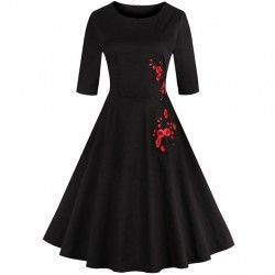 Black vintage dress featuring round neckline