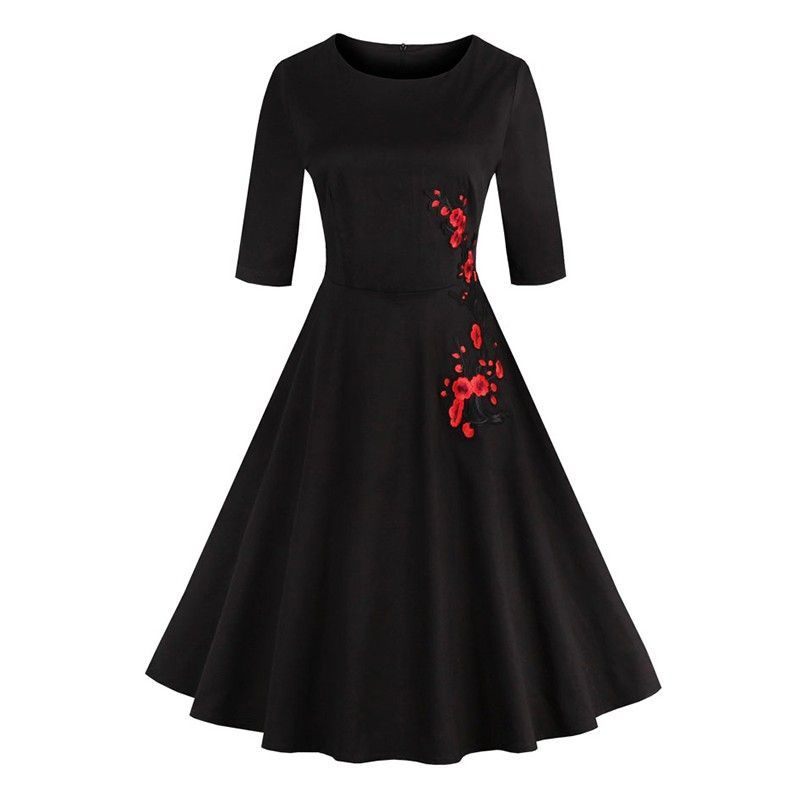 Black vintage dress decorated with embroidery floral print